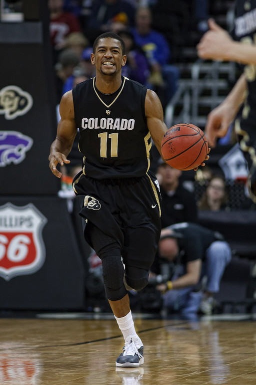 March 10, 2011: Colorado Buffaloes guard Cory Higgins (11) smiles as he brings the ball up court during the quarterfinals of the Phillips 66 Big 12 Men's Basketball Championship.  The Kansas State Wildcats led the Colorado Buffaloes 37-39 at the half at Sprint Center in Kansas City, Missouri.