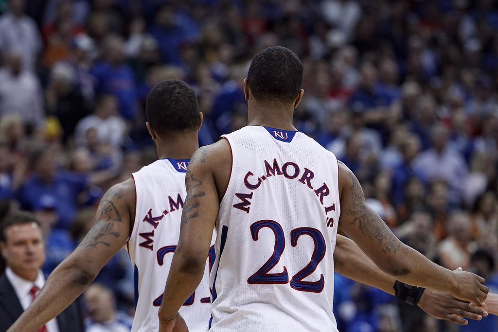 March 12, 2011: Kansas Jayhawks forwards Markieff Morris (21) and Marcus Morris (22) head to the bench for a timeout during the Phillips 66 Big 12 Men's Basketball Championship final.  The Kansas Jayhawks defeated the Texas Longhorns 73-85 at Sprint Center in Kansas City, Missouri.