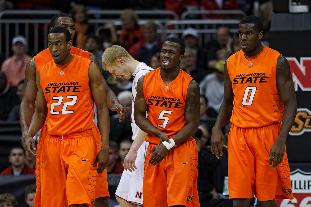 March 9, 2011: Oklahoma State Cowboys guard Reger Dowell (5) holds his wrist in pain after taking a fall during the first round of the Phillips 66 Big 12 Men's Basketball Championship.  The Oklahoma State Cowboys led the Nebraska Cornhuskers 21-30 at the half at Sprint Center in Kansas City, Missouri.
