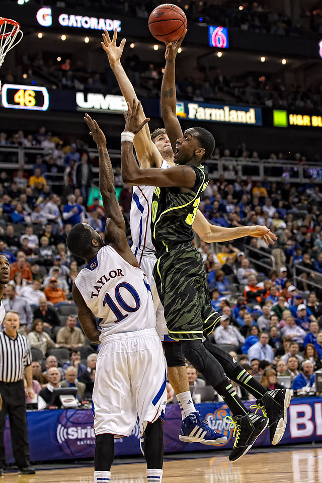 March 9, 2012: Baylor Bears forward Quincy Miller (30) goes up for a shot over Kansas Jayhawks center Jeff Withey (5) during the semifinals of the Phillips 66 Big 12 Men's Basketball Championship.  The Baylor Bears defeated the Kansas Jayhawks 81-72 at Sprint Center in Kansas City, Missouri.