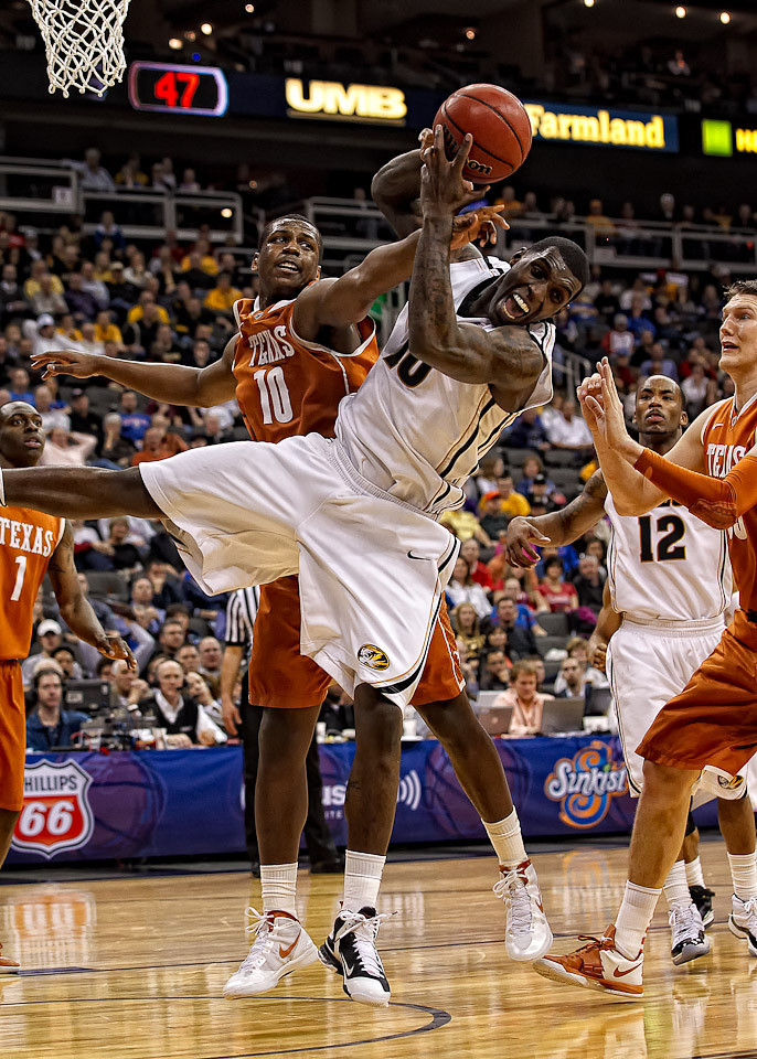 March 9, 2012: Missouri Tigers forward Ricardo Ratliffe (10) gets fouled hard by Texas Longhorns forward Jonathan Holmes (10) during the semifinals of the Phillips 66 Big 12 Men's Basketball Championship.  The Missouri Tigers defeated the Texas Longhorns 81-67 at Sprint Center in Kansas City, Missouri.