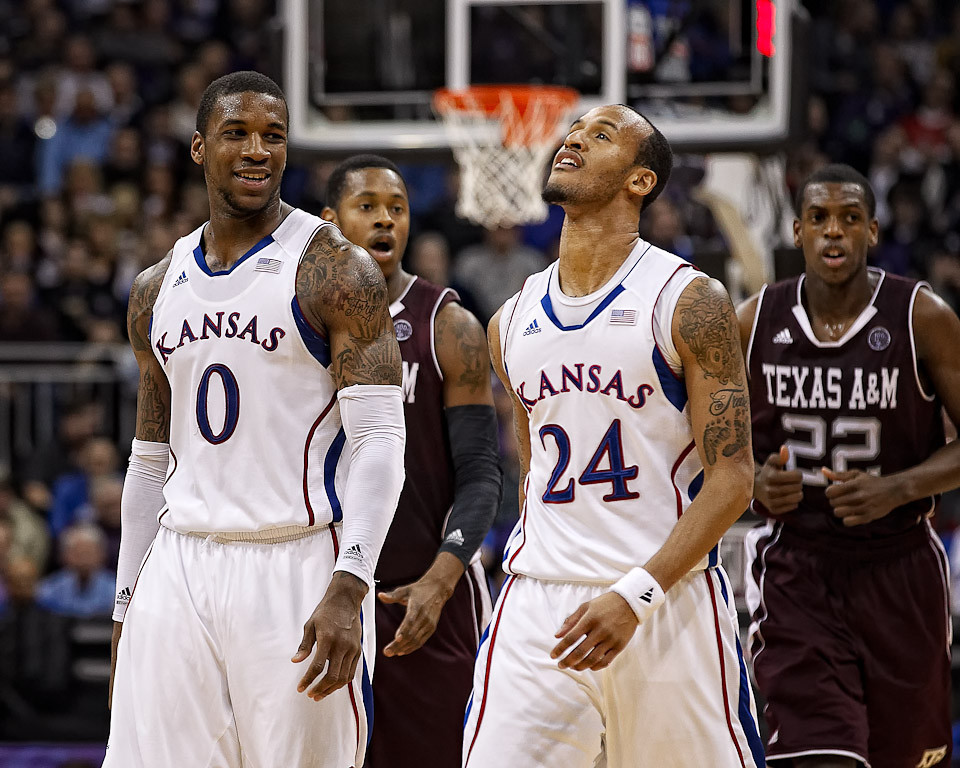 March 8, 2012: Kansas Jayhawks forward Thomas Robinson (0) smiles at guard Travis Releford (24) during the quarterfinals of the Phillips 66 Big 12 Men's Basketball Championship.  The Kansas Jayhawks defeated the Texas A&M Aggies 83-66 at Sprint Center in Kansas City, Missouri.