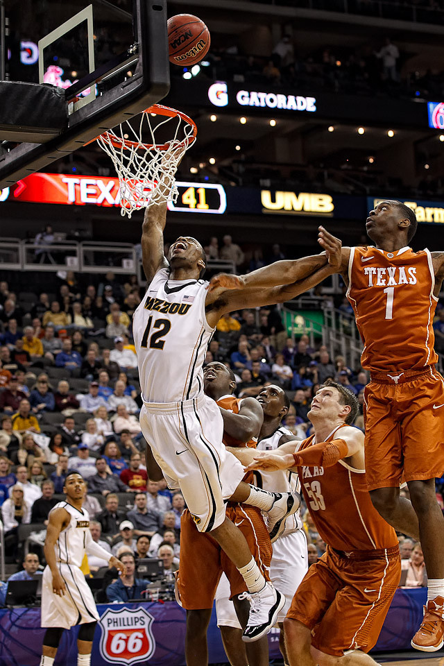 March 9, 2012: Missouri Tigers guard Marcus Denmon (12) goes up for a shot during the semifinals of the Phillips 66 Big 12 Men's Basketball Championship.  The Missouri Tigers defeated the Texas Longhorns 81-67 at Sprint Center in Kansas City, Missouri.