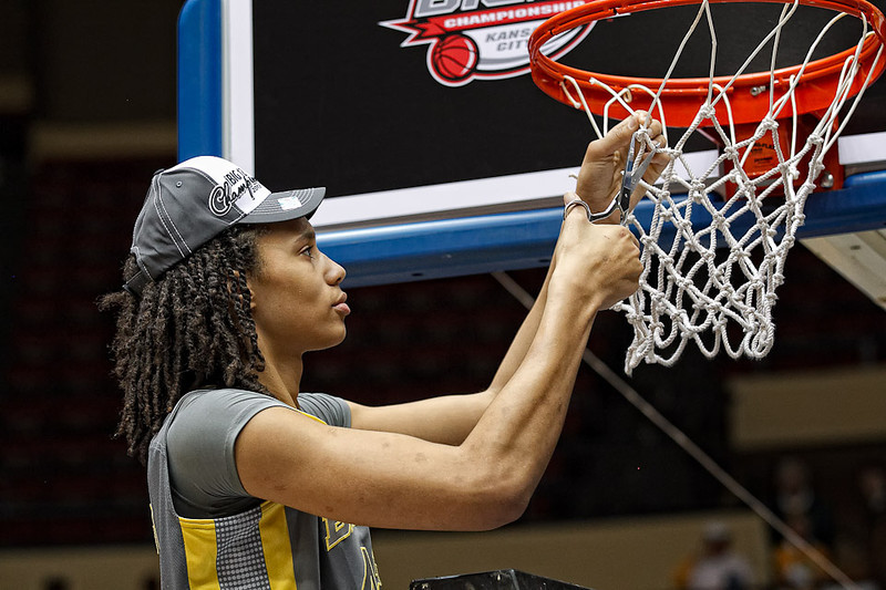 March 10, 2012: Baylor Lady Bears center Brittney Griner (42) cuts a piece of the net after the Phillips 66 Big 12 Women's Basketball Championship final.  The Baylor Lady Bears defeated the Texas A&M Aggies 73-50 at Municipal Auditorium in Kansas City, Missouri.