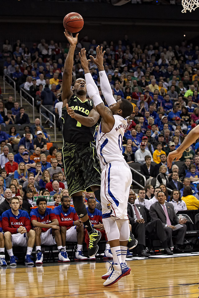 March 9, 2012: Baylor Bears forward Perry Jones III (1) goes up for a shot over Kansas Jayhawks forward Thomas Robinson (0) during the semifinals of the Phillips 66 Big 12 Men's Basketball Championship.  The Baylor Bears led the Kansas Jayhawks 43-35 at the half at Sprint Center in Kansas City, Missouri.