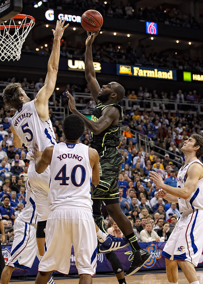 March 9, 2012: Baylor Bears forward Quincy Acy (4) goes up for a shot in the lane while Kansas Jayhawks center Jeff Withey (5) defends during the semifinals of the Phillips 66 Big 12 Men's Basketball Championship.  The Baylor Bears defeated the Kansas Jayhawks 81-72 at Sprint Center in Kansas City, Missouri.