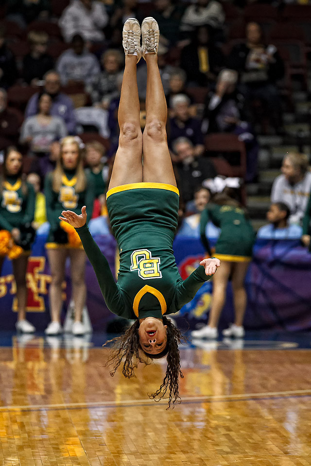 March 10, 2012: A Baylor yell leader tumbles across the court before the Phillips 66 Big 12 Women's Basketball Championship final.  The Baylor Lady Bears defeated the Texas A&M Aggies 73-50 at Municipal Auditorium in Kansas City, Missouri.