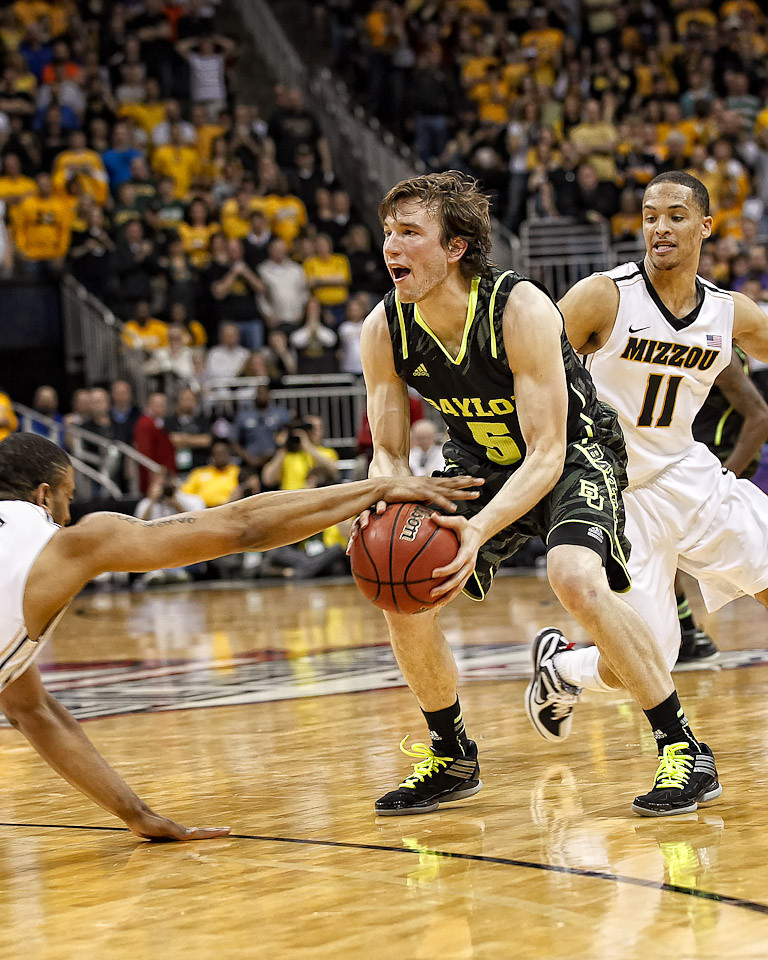 March 10, 2012: Baylor Bears guard Brady Heslip (5) hangs onto the ball during the finals of the Phillips 66 Big 12 Men's Basketball Championship.  The Missouri Tigers defeated the Baylor Bears 90-75 at Sprint Center in Kansas City, Missouri.