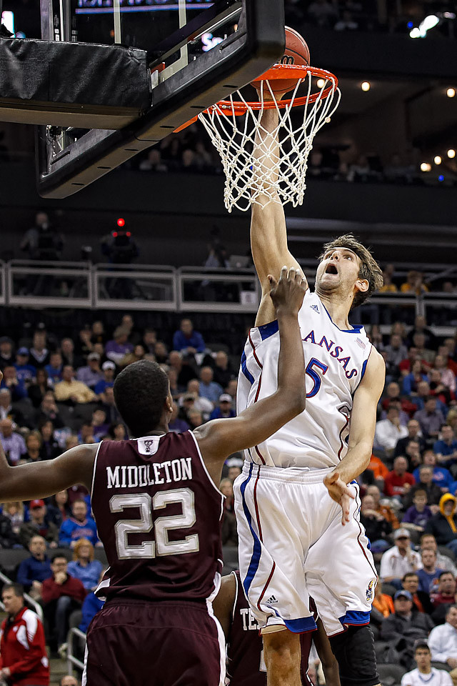 March 8, 2012: Kansas Jayhawks center Jeff Withey (5) slam dunks during the quarterfinals of the Phillips 66 Big 12 Men's Basketball Championship.  The Kansas Jayhawks defeated the Texas A&M Aggies 83-66 at Sprint Center in Kansas City, Missouri.
