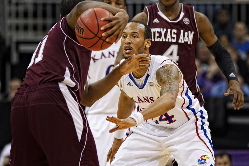 March 8, 2012: Kansas Jayhawks guard Travis Releford (24) defends Texas A&M Aggies guard Elston Turner (31) during the quarterfinals of the Phillips 66 Big 12 Men's Basketball Championship.  The Kansas Jayhawks defeated the Texas A&M Aggies 83-66 at Sprint Center in Kansas City, Missouri.