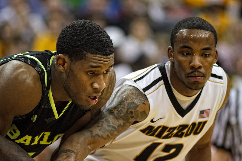 March 10, 2012: Baylor Bears forward Perry Jones III (1) and Missouri Tigers guard Marcus Denmon (12) battle for position during a free throw at the finals of the Phillips 66 Big 12 Men's Basketball Championship.  The Missouri Tigers led the Baylor Bears 43-37 at the half at Sprint Center in Kansas City, Missouri.
