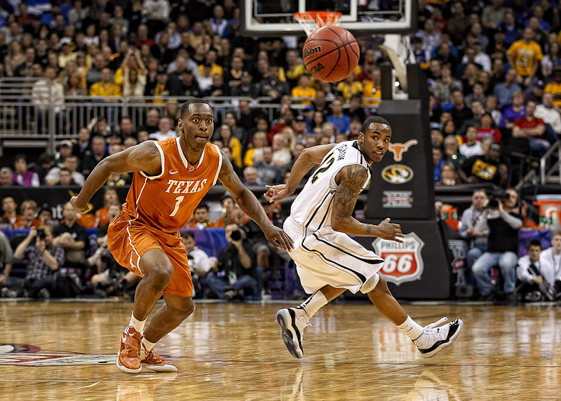 March 9, 2012: Texas Longhorns guard Sheldon McClellan (1) and Missouri Tigers guard Marcus Denmon (12) watch a loose ball during the semifinals of the Phillips 66 Big 12 Men's Basketball Championship.  The Missouri Tigers defeated the Texas Longhorns 81-67 at Sprint Center in Kansas City, Missouri.