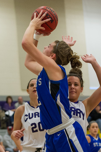 Lindsay Moore (22) shoots during the Women's Basketball game between Saint Joseph's (ME) and Curry Collage at Curry College, Milton, Massachusetts, USA on November 16, 2013. Photo: Chris Poss