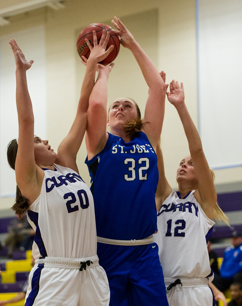 Morgan Cahill (32) shoots during the Women's Basketball game between Saint Joseph's (ME) and Curry Collage at Curry College, Milton, Massachusetts, USA on November 16, 2013. Photo: Chris Poss
