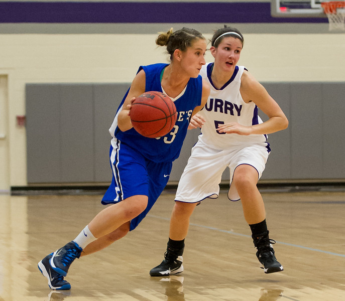 Theresa Hendrix (33) drives down the court during the Women's Basketball game between Saint Joseph's (ME) and Curry Collage at Curry College, Milton, Massachusetts, USA on November 16, 2013. Photo: Chris Poss