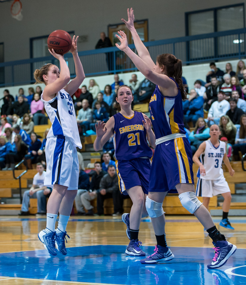 Theresa Hendrix (33) shoots with Mackenzie Dufour (3) in the background during the Women's Basketball game between Saint Joseph's (ME) and Emerson College at Saint Joseph's College, Standish, Maine, USA on February 16, 2013. Photo: Chris Poss