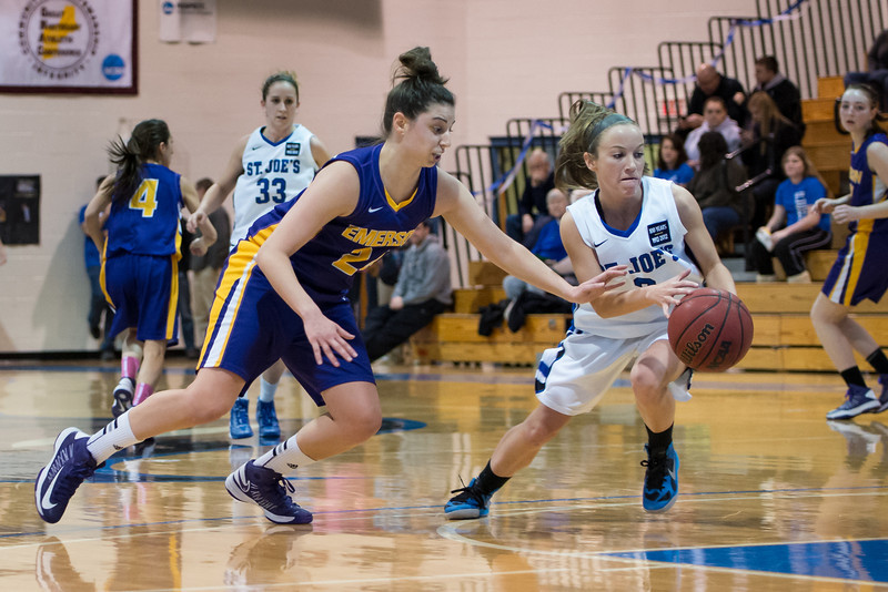 Mackenzie Dufour (3) steals the ball with Theresa Hendrix (33) in the background during the Women's Basketball game between Saint Joseph's (ME) and Emerson College at Saint Joseph's College, Standish, Maine, USA on February 16, 2013. Photo: Chris Poss