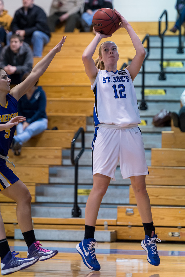 Abby Young (12) shoots during the Women's Basketball game between Saint Joseph's (ME) and Emerson College at Saint Joseph's College, Standish, Maine, USA on February 16, 2013. Photo: Chris Poss