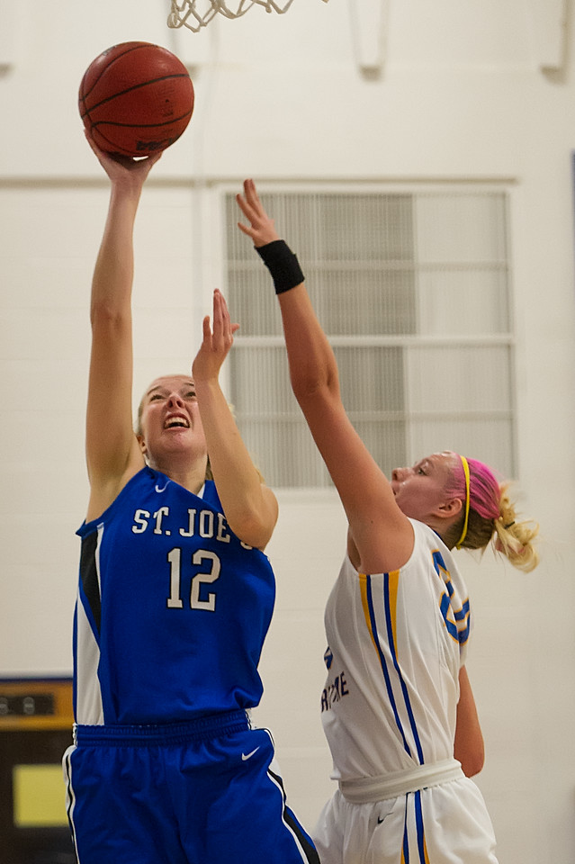 Abby Young (12)  shoots during the Women's Basketball game between Saint Joseph's (ME) and Maine Maritime Academy at Maine Maritime Academy, Castine, Maine, USA on November 23, 2013. Photo: Chris Poss