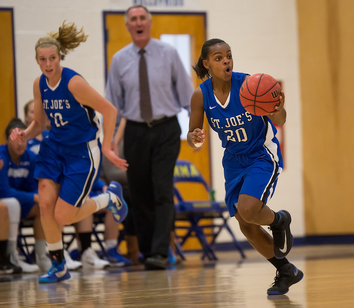 Sarah Assante (20)  brings the ball down court as Abby Young (12)  follows during the Women's Basketball game between Saint Joseph's (ME) and Maine Maritime Academy at Maine Maritime Academy, Castine, Maine, USA on November 23, 2013. Photo: Chris Poss