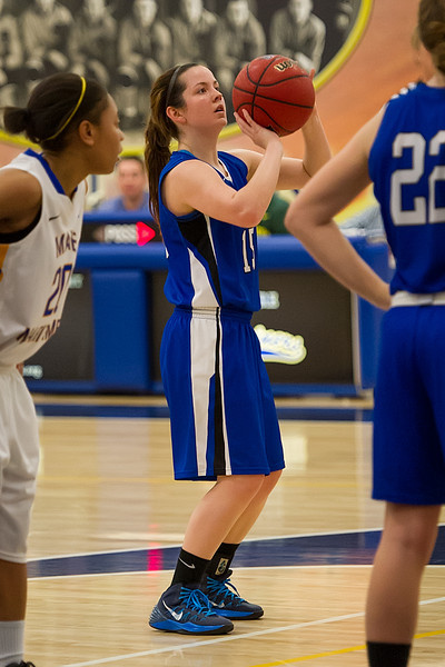 Abbie Eastman (15) shoots from the free throw line during the Women's Basketball game between Saint Joseph's (ME) and Maine Maritime Academy at Maine Maritime Academy, Castine, Maine, USA on November 23, 2013. Photo: Chris Poss