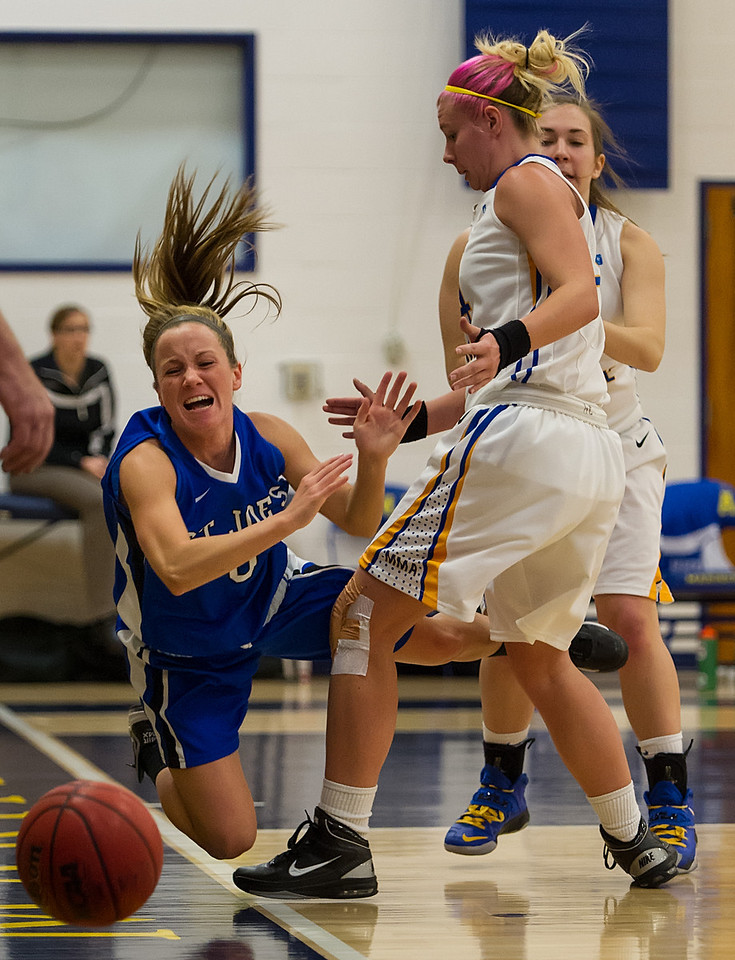 Mackenzie Dufour (3)  is pushed out of bounds during the Women's Basketball game between Saint Joseph's (ME) and Maine Maritime Academy at Maine Maritime Academy, Castine, Maine, USA on November 23, 2013. Photo: Chris Poss