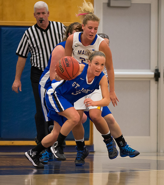 Mackenzie Dufour (3) starts down the court during the Women's Basketball game between Saint Joseph's (ME) and Maine Maritime Academy at Maine Maritime Academy, Castine, Maine, USA on November 23, 2013. Photo: Chris Poss