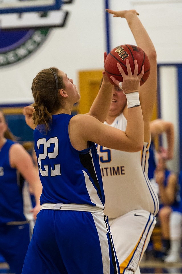 Lindsay Moore (22) shoots during the Women's Basketball game between Saint Joseph's (ME) and Maine Maritime Academy at Maine Maritime Academy, Castine, Maine, USA on November 23, 2013. Photo: Chris Poss