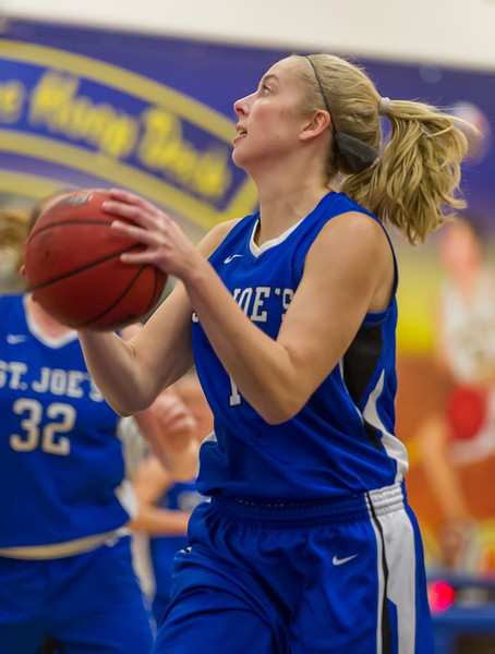 Abby Young (12)  looks to shoot during the Women's Basketball game between Saint Joseph's (ME) and Maine Maritime Academy at Maine Maritime Academy, Castine, Maine, USA on November 23, 2013. Photo: Chris Poss