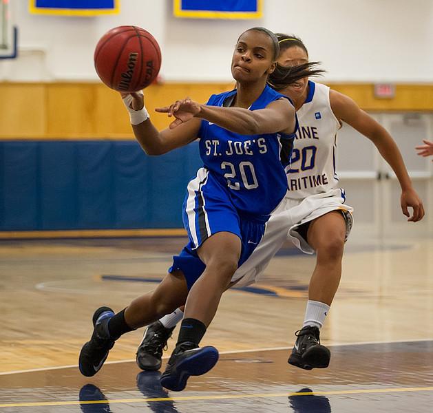 Sarah Assante (20)  shoots during the Women's Basketball game between Saint Joseph's (ME) and Maine Maritime Academy at Maine Maritime Academy, Castine, Maine, USA on November 23, 2013. Photo: Chris Poss
