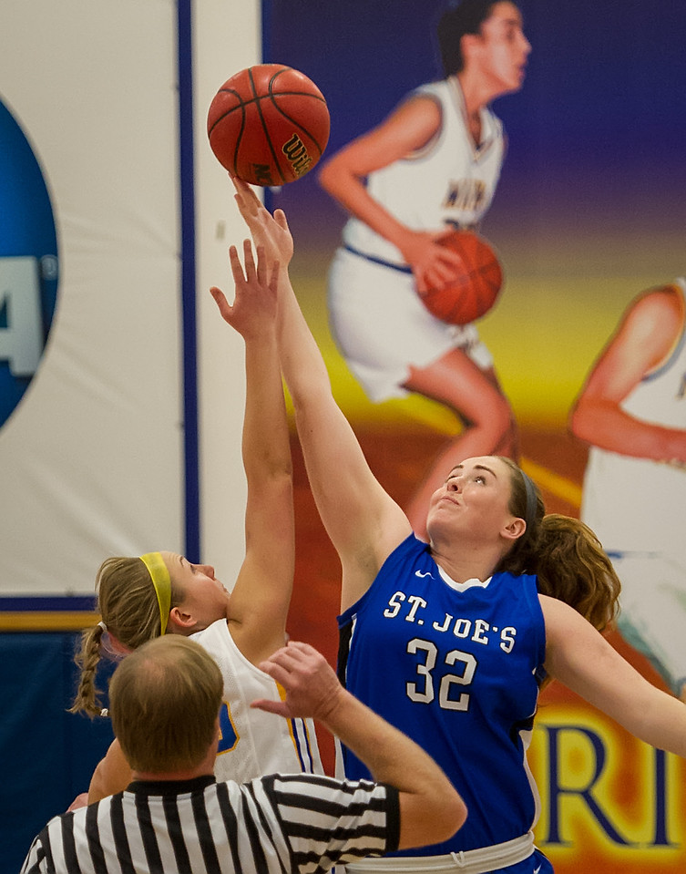 Morgan Cahill (32) controls the starting tip off during the Women's Basketball game between Saint Joseph's (ME) and Maine Maritime Academy at Maine Maritime Academy, Castine, Maine, USA on November 23, 2013. Photo: Chris Poss