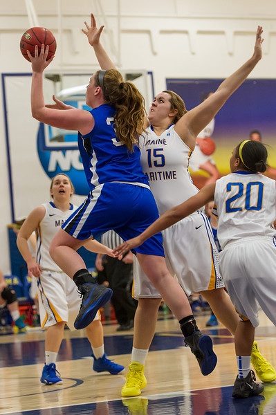 Morgan Cahill (32)  shoots during the Women's Basketball game between Saint Joseph's (ME) and Maine Maritime Academy at Maine Maritime Academy, Castine, Maine, USA on November 23, 2013. Photo: Chris Poss