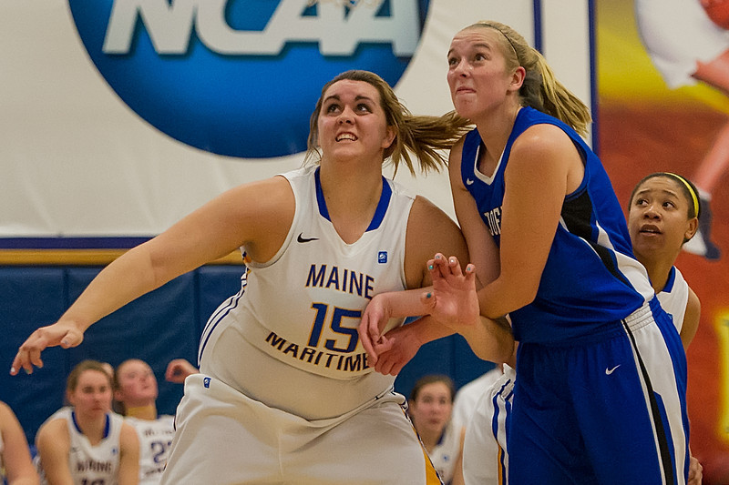 Abby Young (12) fights to get rebounding position during the Women's Basketball game between Saint Joseph's (ME) and Maine Maritime Academy at Maine Maritime Academy, Castine, Maine, USA on November 23, 2013. Photo: Chris Poss