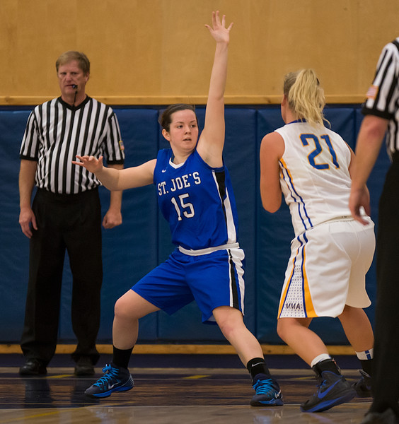 Abbie Eastman (15)  on defense during the Women's Basketball game between Saint Joseph's (ME) and Maine Maritime Academy at Maine Maritime Academy, Castine, Maine, USA on November 23, 2013. Photo: Chris Poss