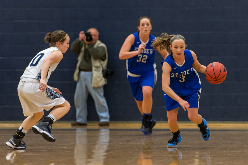 Mackenzie Dufour (3) and Morgan Cahill (32) drive down the court after a rebound during the Women's Basketball game between Saint Joseph's (ME) and Rivier University at Rivier University, Nashua, New Hampshire, USA on January 12, 2013. Photo: Chris Poss