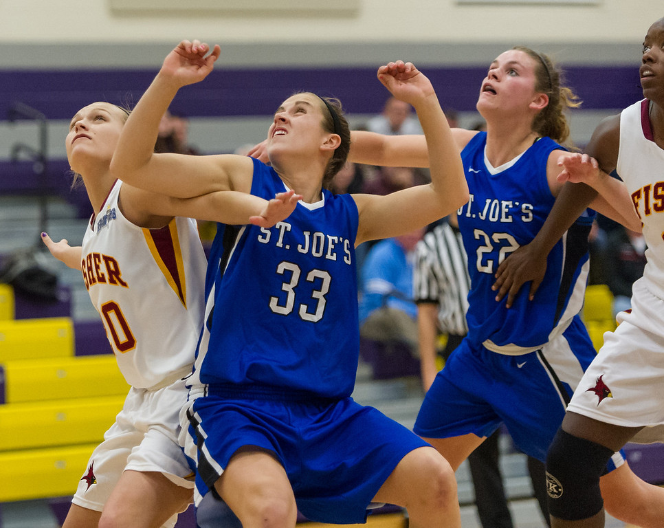 Theresa Hendrix (33) and Lindsay Moore (22) work to gain position for a rebound during the Women's Basketball game between Saint Joseph's (ME) and Saint John Fisher at Curry College, Milton, Massachusetts, USA on November 15, 2013. Photo: Chris Poss