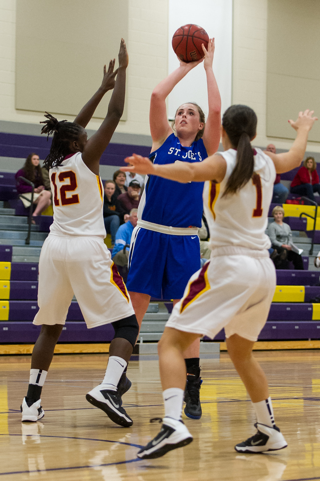 Morgan Cahill (32) shoots during the Women's Basketball game between Saint Joseph's (ME) and Saint John Fisher at Curry College, Milton, Massachusetts, USA on November 15, 2013. Photo: Chris Poss