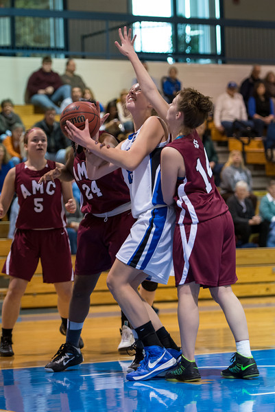 Abby Young (12) looks to shoot during the Women's Basketball game between Saint Joseph's (ME) and Anna Maria College at Saint Joseph's College, Standish, Maine, USA on January 19, 2013. Photo: Chris Poss