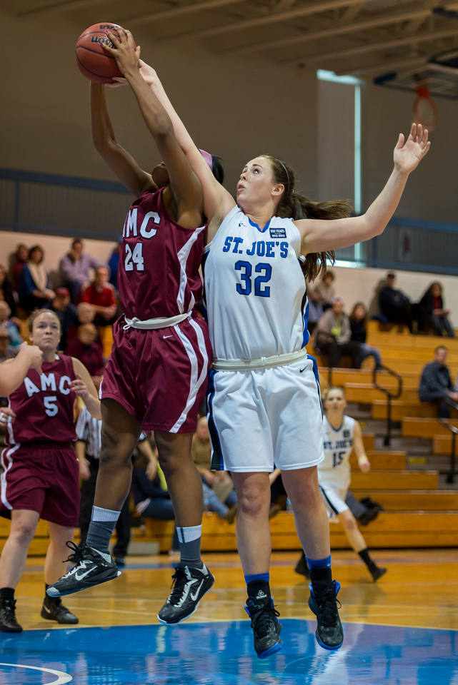 Morgan Cahill (32) fights for a rebound during the Women's Basketball game between Saint Joseph's (ME) and Anna Maria College at Saint Joseph's College, Standish, Maine, USA on January 19, 2013. Photo: Chris Poss