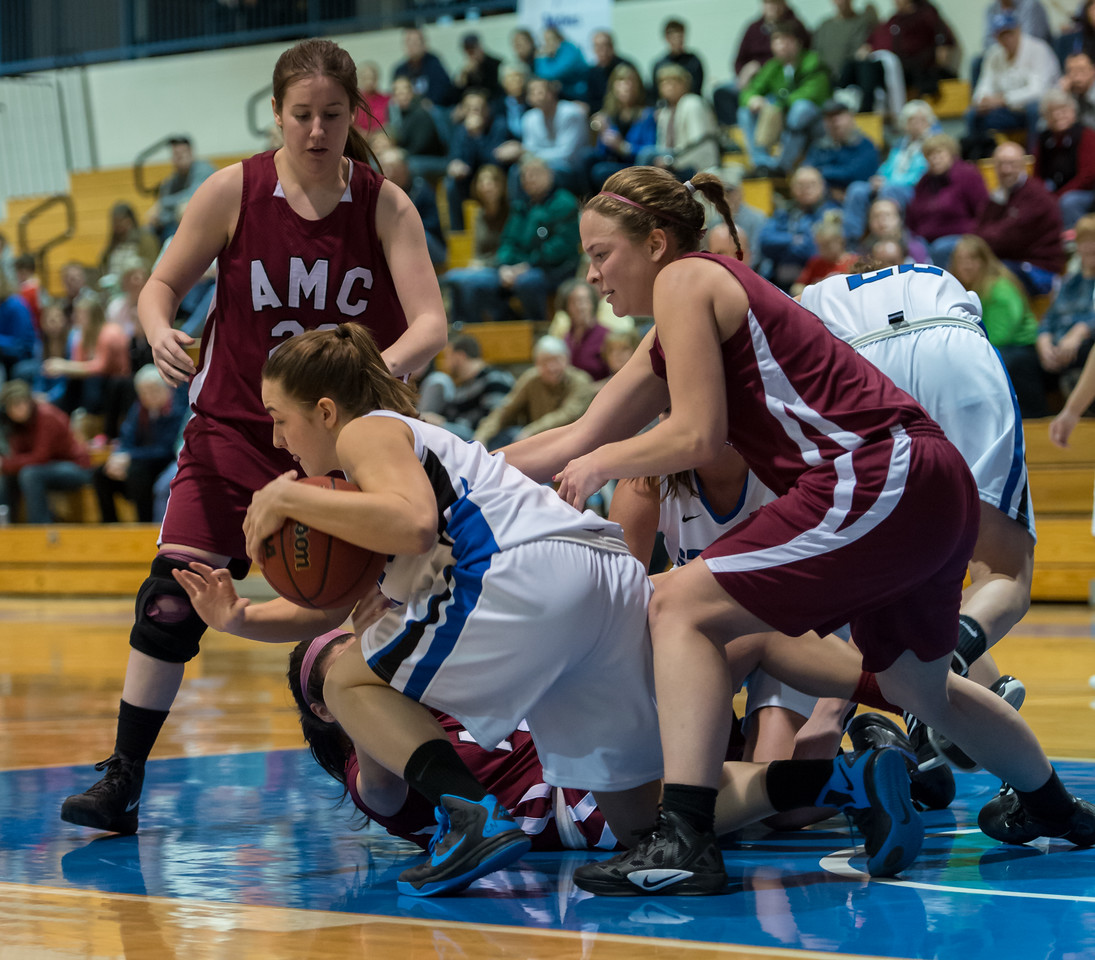 Skyler Makkinje (4) grabs a loose ball with Lindsay Moore (22) in the background during the Women's Basketball game between Saint Joseph's (ME) and Anna Maria College at Saint Joseph's College, Standish, Maine, USA on January 19, 2013. Photo: Chris Poss