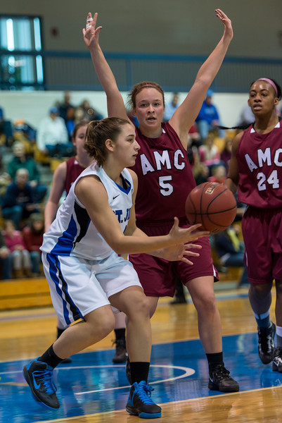 After getting a rebound, Skyler Makkinje (4) passes to a teammate  during the Women's Basketball game between Saint Joseph's (ME) and Anna Maria College at Saint Joseph's College, Standish, Maine, USA on January 19, 2013. Photo: Chris Poss