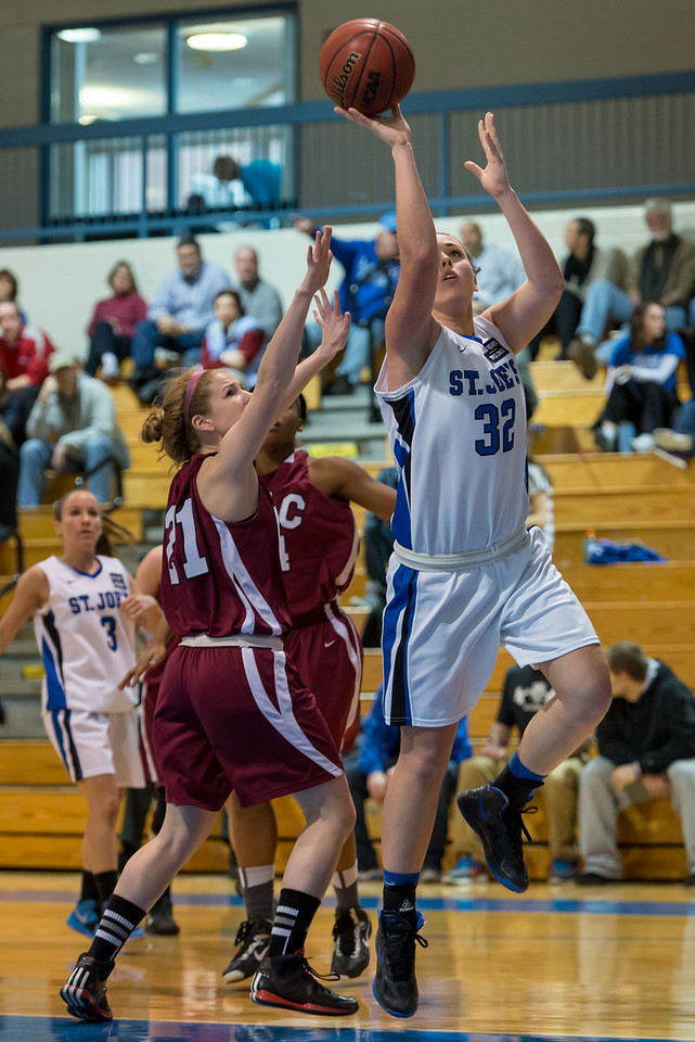 Morgan Cahill (32) shoots a layup during the Women's Basketball game between Saint Joseph's (ME) and Anna Maria College at Saint Joseph's College, Standish, Maine, USA on January 19, 2013. Photo: Chris Poss