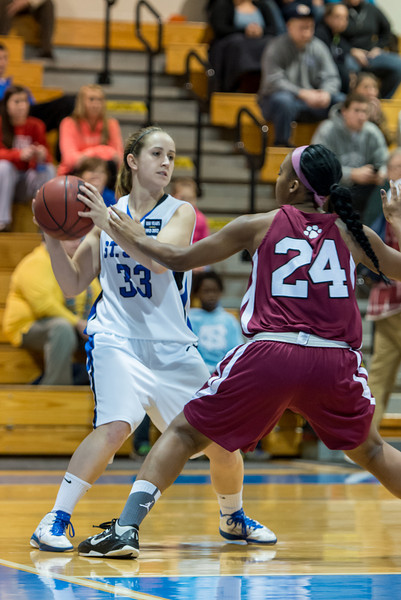 Theresa Hendrix (33) looks to pass during the Women's Basketball game between Saint Joseph's (ME) and Anna Maria College at Saint Joseph's College, Standish, Maine, USA on January 19, 2013. Photo: Chris Poss