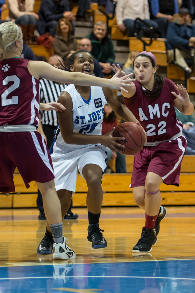 Sarah Assante (20) drives to the basket during the Women's Basketball game between Saint Joseph's (ME) and Anna Maria College at Saint Joseph's College, Standish, Maine, USA on January 19, 2013. Photo: Chris Poss