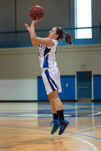 Skyler Makkinje (4) shoots during the Women's Basketball game between Saint Joseph's (ME) and Emmanuel College at Saint Joseph's College, Standish, Maine, USA on February 02, 2013. Photo: Chris Poss