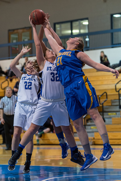 Morgan Cahill (32) and Lindsay Moore (22) work to grab a rebound during the Women's Basketball game between Saint Joseph's (ME) and Emmanuel College at Saint Joseph's College, Standish, Maine, USA on February 02, 2013. Photo: Chris Poss