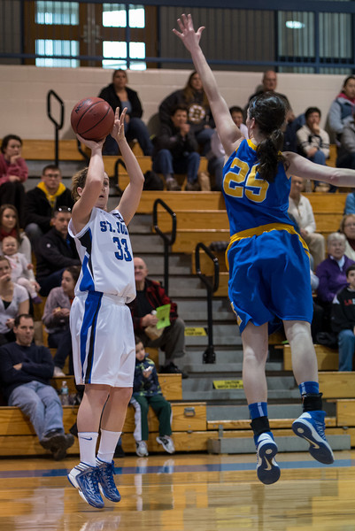 Theresa Hendrix (33) shoots during the Women's Basketball game between Saint Joseph's (ME) and Emmanuel College at Saint Joseph's College, Standish, Maine, USA on February 02, 2013. Photo: Chris Poss
