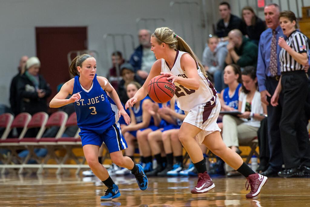 Mackenzie Dufour (3) playing defense during the Women's Basketball game between Saint Joseph's (ME) and Norwich University at Norwich University, Northfield, Vermont, USA on January 05, 2013. Photo: Chris Poss