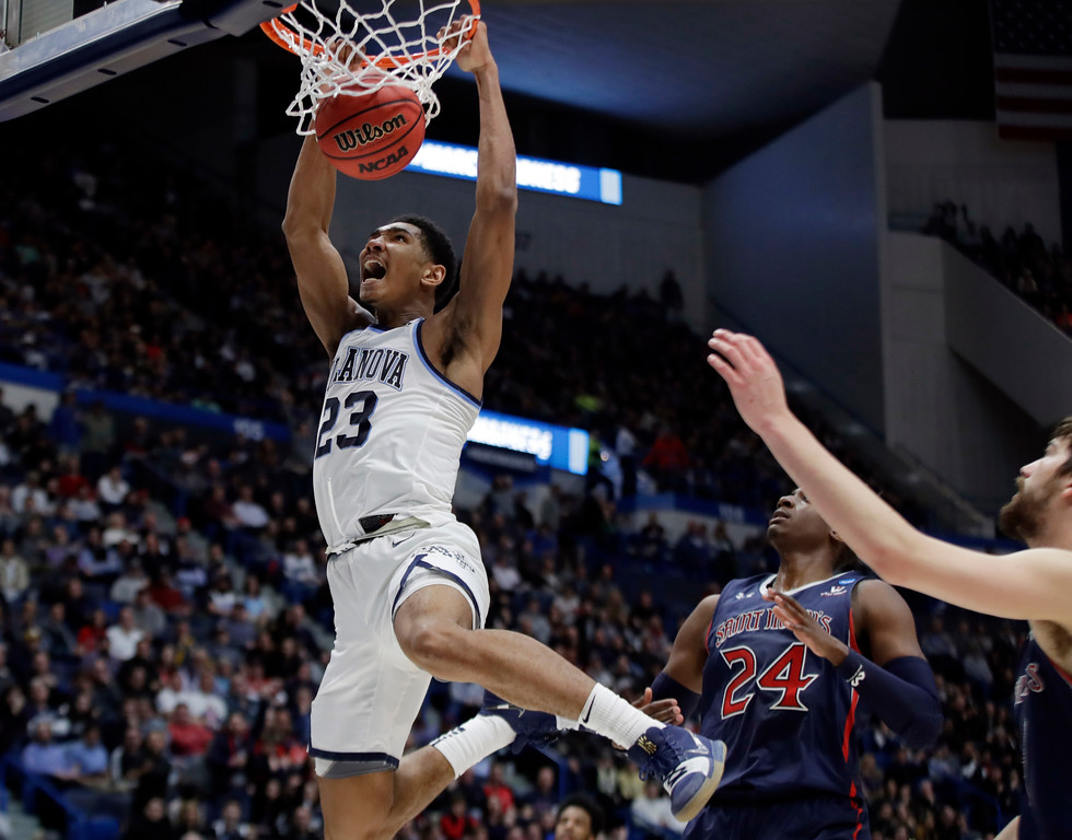 . Villanova\'s Jermaine Samuels (23) dunks against St. Mary\'s Malik Fitts (24) during the second half of a first round men\'s college basketball game in the NCAA Tournament, Thursday, March 21, 2019, in Hartford, Conn. (AP Photo/Elise Amendola)