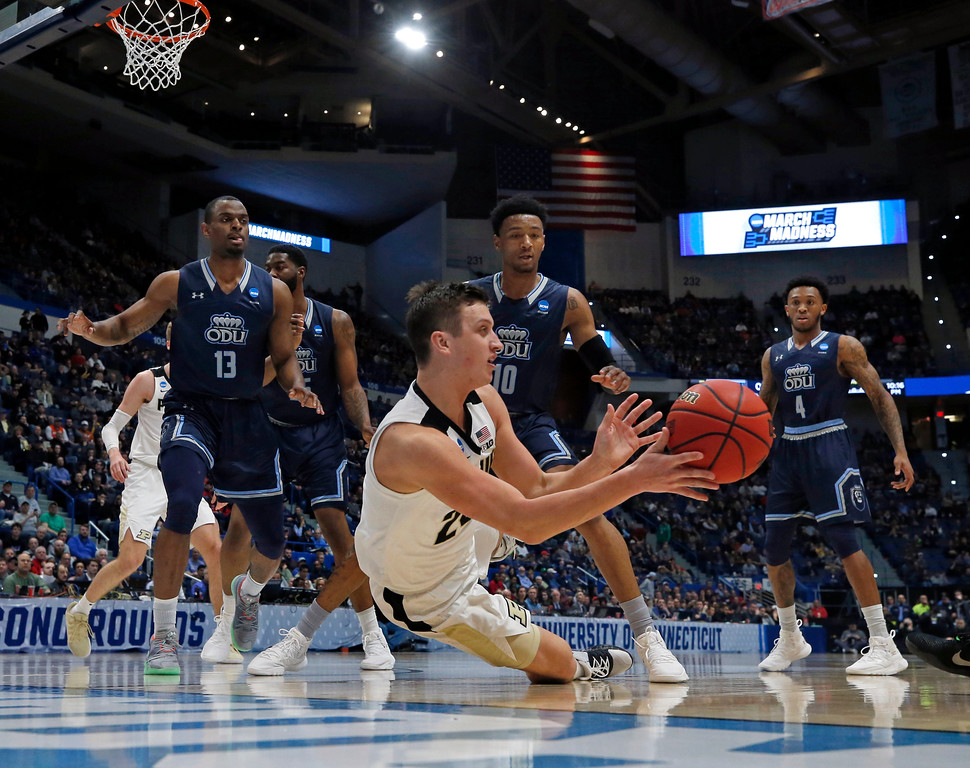 . Purdue\'s Grady Eifert (24) dives to control a rebound against Old Dominion\'s Aaron Carver (13), Xavier Green (10) and Ahmad Caver (4) during the first half of a first round men\'s college basketball game in the NCAA Tournament, Thursday, March 21, 2019, in Hartford, Conn. (AP Photo/Elise Amendola)